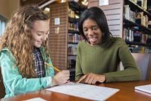 Woman mentoring a young girl (Photo: Steven Debenport/iStock)