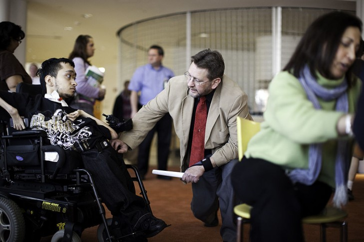 Frank Buonomo, Employment Specialist for Goodwill speaks to Norbrian Rivera  employment conference and career fair for unemployed people with disabilities.   (Photo by Christopher Capozziello/Getty Images)