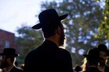 Hasidic men wait for a procession (Photo by Ramin Talaie/Getty Images)