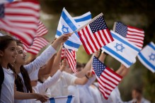 Israeli children wave flags during a rehearsal, a day a head of the arrival of US President Barack Obama at the president's residence on March 19, 2013 in Jerusalem, Israel.  (Photo by Uriel Sinai/Getty Images)