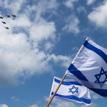 Israeli flags wave on the beach in the Mediterranean sea as a military air show marks the anniversary of Israel's independence on April 16 in Tel Aviv, Israel. The day marks when David Ben-Gurion, the Executive Head of the World Zionist Organization declared the establishment of a Jewish state in Eretz- Israel.  (Photo by Uriel Sinai/Getty Images)