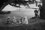 Ghislaine and Ceres Randall watching their teddy bears enjoy a picnic in Wells, Somerset.  (Photo by Keystone/Getty Images)