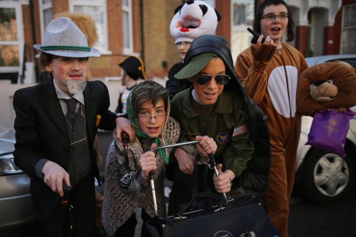 Costumed children celebrate Purim in London (Photo by Dan Kitwood/Getty Images)