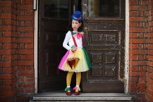 A young Jewish child wears fancy dress during the holiday of Purim in London, England. (Photo by Dan Kitwood/Getty Images)