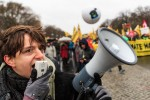 An activist speaks into a megaphone during the Global Climate March on November 29, 2015 in Berlin, Germany  (Photo by Carsten Koall/Getty Images)