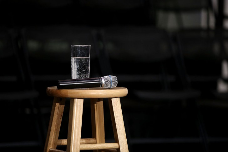 A microphone and glass of water for a public speaker.  (Photo by Justin Sullivan/Getty Images)
