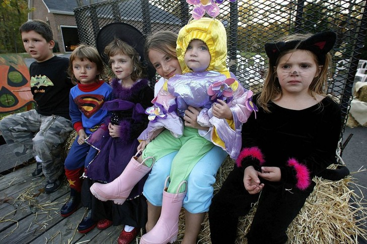 Young children dressed in various costumes get ready for a hay ride in Huntingtown, Maryland. (Photo by Mark Wilson/Getty Images)