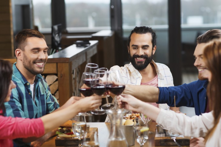 Friends dining and drinking (Photo: dolgachov/iStock)