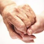 old_hand_holding_young_150x150_medium