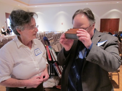 Meyer shows family slide collection to Bernard Fishman at February JGSGB program.