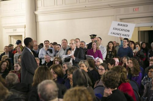Newton Mayor Setti Warren, left, took a question from Charles Jacobs at a community discussion on making sure Newton is a welcoming place for all, at an event on April 7. (KATHERINE TAYLOR FOR THE BOSTON GLOBE)