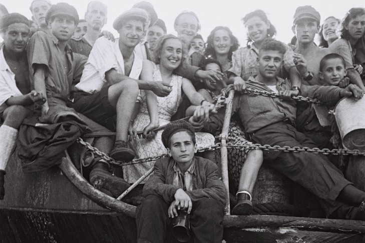 "A group of young ""illegal"" immigrants on board the Hagana ship ""Jewish State"" entering the Haifa Port. (Photo credit: Colliding Dreams)"