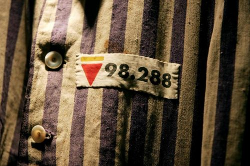 The prison uniform of Auschwitz survivor Leon Greenman is displayed in 2004 at the Jewish Museum in London, England. (IAN WALDIE/GETTY IMAGES)