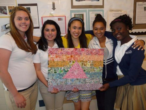 Foxborough students with artwork made from collected postage stamps