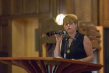 In this file photo, Idit Klein, executive director of the Boston-based Keshet for LGBTQ Jews and their allies, addresses up to 200 attendees at a Memorial and Solidarity Gathering at Boston's Temple Israel on September 9, 2015 (Elan Kawesch/The Times of Israel)