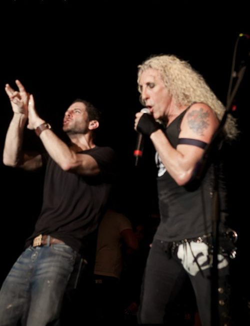 "Rabbi Darby Leigh, left, using sign language onstage in New York with Twisted Sister's lead singer Daniel ""Dee"" Snider (Photo credit: PopJewish.com)"