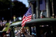 A man waves an American flag in the Independence Day parade in Barnstable. (MIKE SEGAR/REUTERS)