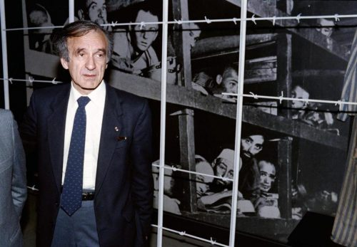 Nobel laureate and writer Elie Wiesel stood in front of a photo of himself and other inmates that was taken at Buchenwald in 1945. (SVEN NACKSTRAND/AFP/GETTY IMAGES/FILE 1986)