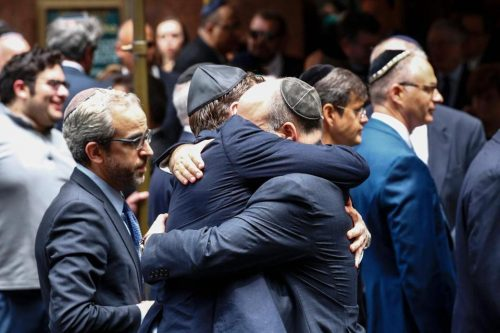 People embraced outside the Fifth Avenue Synagogue during the funeral for Elie Wiesel on Sunday. (KENA BETANCUR/AFP/GETTY IMAGES)