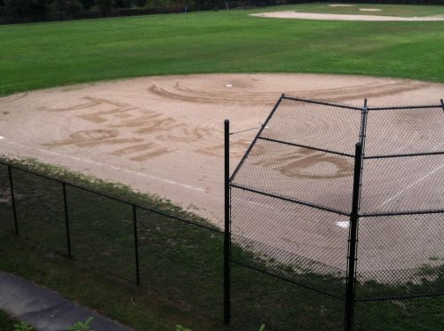 """The message """"Jews did 9/11"""" was inscribed in the dirt of the softball field at Marblehead High School last week. (MARBLEHEAD POLICE)"""