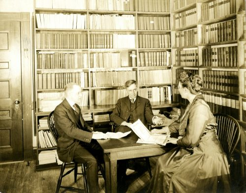 Louis D. Brandeis with Alice Grady and Irving Hurst on Jan. 11, 1916, in the library of Brandeis, Dunbar & Nutter. Hurst was Massachusetts state actuary, and Grady, Brandeis' secretary, went on to become the first deputy commissioner of SBLI. (Photo credit: Robert D. Farber University Archives & Special Collections Department, Brandeis University)