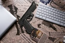 desk-newspaper-headlines-gun-770×400