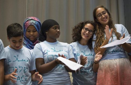 Several of the young adults involved in the Kids4Peace Boston program gave a presentation at Temple Beth Avodah in Newton on Sunday about their peace-building experiences. (DINA RUDICK/GLOBE STAFF)