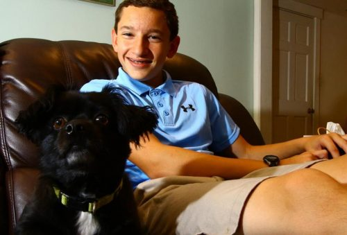 Max Davis at home in Stoneham with the family pet, Beau. (MARK LORENZ FOR THE BOSTON GLOBE)