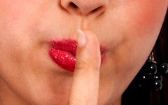 Girl With Her Finger To Her Lips Asking Us To Be Quiet