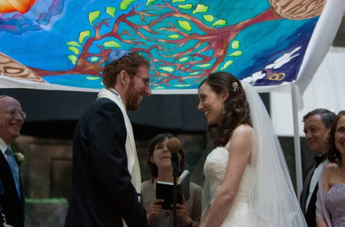 Intermarried couples whose weddings were officiated by Jewish clergy as the only officiant are more highly engaged in Jewish life than other intermarried couples, a new study has found. (Ashley Novack)